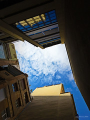 the sky over my head (pàmies photo) Tags: architecture building city cityscape sky bluesky skyscape buildings skyscrape urban cities town street beautiful lookingup composition geometry perspective geometric