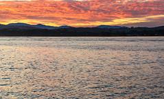 Pink Cloud Sunset on the Coast (Merrillie) Tags: sand landscape sunset nature australia mountains newsouthwales sea sun batemansbay beach scenery orange trees pink coastal southcoast nsw waterscape clouds coast water seascape