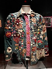 "Hippie button slogans jacket on display at the ""Summer of Love"" exhibit at the de Young Museum in San Francisco. (ArtsySF©Marjie) Tags: flickrheroes 10000hippiescametosf summerof1967 sanfrancisco denium buttons slogans jacket hippie deyoungmuseum summeroflove"