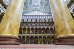 National Building Museum Interior (jtgfoto) Tags: approved architecture nationalbuildingmuseum nbm washington washingtondc dc historic building structure sonyimages sonyalpha judiciarysquare interior columns openspace perspective wideangle wideanglelens rokinon lookup height gold pedestals