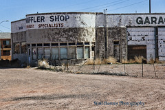 Old garage in Holbrook, Ariz. (Walt Barnes) Tags: auto automotive muffler holbrook arizona architecture sign signage cement streetscene canon eos 60d eos60d canoneos60d wdbones99 topazsoftware pse15 sand dirt