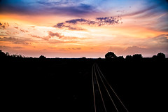 The evening sky (Peter Leigh50) Tags: sunset clouds cloudscape sky skyscape railway track evening pink grey black