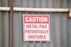Stating the Obvious (Bad Alley (Cat)) Tags: metal scrapmetal metalpile giantmetalpile saskatoon junk scrap grey brown rush sign warning red unstable