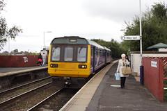 20090930 048 Hollinwood. 142033 2J80 14.37 Manchester Victoria - Shaw and Crompton (15038) Tags: railways trains br britishrail lancashireyorkshirerailway lyr lms oldhamloop disused lostlines hollinwood 142033 diesel dmu class142