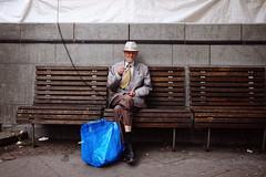 Man with disco hat and IKEA bag (polybazze) Tags: malmö man street streetlife fujifilm fujifilmx100t x100t ikea bum suit disco sweden