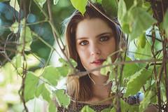 Waiting to be discovered (Vincent F Tsai) Tags: portrait girl fashion art fineart face eyes young beauty beautiful vines leaf tree frame framing emotion mood bokeh dof olympusmzuiko75mmf18 panasonic lumixg5