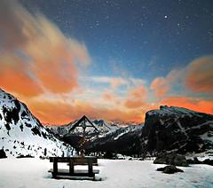 Glowing clouds (Robyn Hooz) Tags: valparola passo cielo notte night neve stelle snow white orange strange wierd sky astronomy dolomites dolomiti