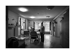 The Caregiver (Jan Dobrovsky) Tags: 21mm leicam people reallife mood grain humanity indoor contrast monochom care mentallyhandicapped blackandwhite northernbohemia caregiver human monochrome document