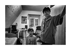 The girl and the governess (Jan Dobrovsky) Tags: portrait childrenshome leicaq monochrome people kids blackandwhite northernbohemia contrast grain indoor document girl