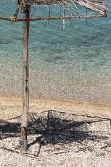 Sunshade shadow-20170603-3158 (old.pappous) Tags: crete kalami soudabay beachumbrella broken disintegrating reedcanopy rotted rotten shadow shingle sunshade creteregion greece gr