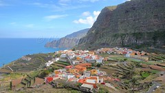 AGULO, LA GOMERA, SPAIN: General view of the village with terraced fields and cliffs in the background (christophe.cappelli) Tags: lagomera canaryislands spain agulo europe village terraced fields palm tree cliffs mountain atlantic ocean green colorful colors