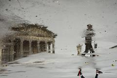 Racconti di pioggia - Rain stories. (sinetempore) Tags: raccontidipioggia rainstories pioggia rain pozzanghera puddle riflessi reflexes reflections acqua water street uomo man granmadredidio church chiesa torino turin