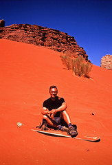 Gaspard covered in sand (louis de champs) Tags: minoltasrt101 agfaprecisa100 vividcolors film redsand desert dune wadirum jordan sandsurfing surf