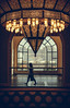 Chandelier (relishedmonkey) Tags: nikon d5300 ibn batuta lighting outline person walking chandelier 35mm18g design day dubai uae city yellow moody woman one