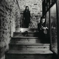 Asylum III (Dara Scully) Tags: child children childhood littlegirl twins film square disturbing suggestive darkness light candle mirror