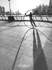 It's a long story~ Shanghai (~mimo~) Tags: shotoniphone shotoniphone7 iphone7 iphone circle acrobat man sun cityscape city shadow sunrise street urban china shanghai bund