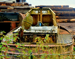 ONCE A CHEEKY LOG SORTER WHO HAD TEETH.  NOW A WASTED PIECE OF MACHINERY ON THE BANKS OF FRASER RIVER.  (SAWMILL), NEAR MISSION,  BC. (vermillion$baby) Tags: silvercreekpremiumproducts abandoned boat flickr machine mess mission old rust sad sawmill stern water tool