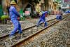 Working on the railway, Hanoi (Goran Bangkok) Tags: hanoi vietnam rail railroad persons men workers blue hat green daytime tripple hoan kiem old quarter town fujixt2