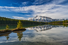 Morning at Two Jack Lake (Quincey Deters) Tags: allrightsreserved ©quinceydeters nature canada outdoor horizontal 2017 may colourimage reflection colourful coolcolour art photoart landscape lake island water mountain peak snow tree forest waterreflection northamerica alberta banffnationalpark twojacklake mountrundle rockymountains canadianrockymountains morning spring sky bluesky cloud