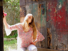 On The Edge ... (MargoLuc) Tags: sunlight lagodicomo house ancient darsena door me self portrait girl woman blonde glow backlight pink colourful blouse red rose jeans spring feeling closing eyes beautiful sunny day italy