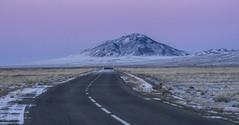 desert dusk (cih94) Tags: dusk sunset gobi desert snow mountain purple sky road perspective mongolia ulaan bataar leaving roadtrip landscape scenery fotocompetition fotocompetitionbronze
