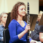 Student sitting with her clarinet.