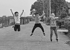 jump (poludziber1) Tags: street streetphotography sky shanghai cityscape city china kids kid travel urban blackwhite people mpt561 matchpointwinner
