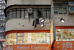 """sunny lighting"" (hugo poon - one day in my life) Tags: xt2 35mm hongkong mongkok shanghaistreet vanishing cornerbuilding lights sign windowtypeac laundry solitude aged shop reminiscing"