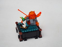 Explosion on Gunpowder Isle (Robert4168/Garmadon) Tags: lego microship microbuild border volcano eruption water flags eslandola gunpowder island brethrenofthebrickseas summer joust transorange