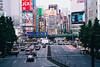 Beauty and the Beast (hidesax) Tags: beautyandthebeast shinjuku tokyo japan cityscape street intersection elevated railway buildings cars hidesax leica m240 teleelmaritm 90mm f28