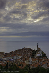Cloudy cityscape of Piran, Slovenia (- photozol -) Tags: piran primorskaistria slovenia sony nex7 sel24f18z zeiss city cityscape landscape adriatic coast sea europe eastern gulf mirrorless building architecture old travel town tradition art istria st georges parish