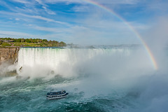 Niagara Rainbow and the Mist (Aleem Yousaf) Tags: maidofthemist niagrafalls travel tourism usa maid mist sightseeing niagara falls waterfalls canada northamerica ontario canadianborder pictures horseshoe border united states america pics photographs usaborder lakeontario lakeerie rainbow sky clouds circular polarizer