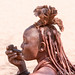 Himba woman with pipe
