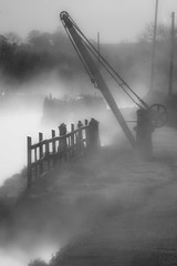 Canal and Crane (Julian Barker) Tags: trent mersey canal swarkestone derby derbyshire england uk europe black white monochrome lifting early morning mist crane fence silhouette water atmosphere julian barker canon dslr 600 industrial heritage revolution