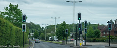 All Go (M C Smith) Tags: traffic lights green pentax k3 houses trees hedges bushes lamps footbridge vans cars sky blue clouds white