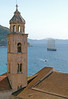The bell tower of the Dominican Monastery in front of the Adriatic Sea