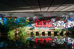 Graffiti, Light, Reflection (BigRedTroll) Tags: architecture blue bridge canal color concrete england graffiti light northampton northamptonshire northants red redwhiteandblue reflection shadows structure threecounties water white