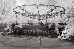 Apocalyptic merry-go-round (Sean Hartwell Photography) Tags: merrygoround fallout fairground funfair amusements amusementpark ir infrared nuclear disaster abandoned chernobyl pripyat ukraine ussr 1986 canoneosm
