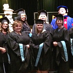 Graduates pose in Orr Auditorium