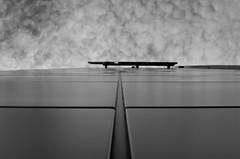 power up (Paul B. (Halifax)) Tags: nikon d7000 nikkor35mm18g halifaxwaterfront novascotia canada novascotiapowernspcorporateheadquarters lookingup bw blackandwhite urbanabstract architecture symmetry lines clouds