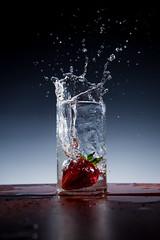 splash (wratten25) Tags: high speed splash flash water fruit strawberry miops strobist