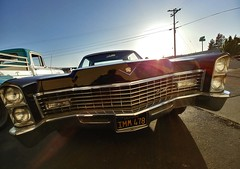 The Caddy (RZ68) Tags: 1967 cadillac seville hardtop hard top black car old classic vintage street sun sunset san francisco bay area california evening wide angle lg g6 camerphone smart phone road parked grill front end headlights flare ford truck