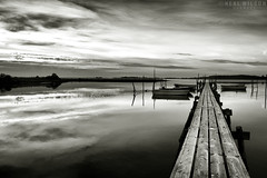 bnw sunrise (Neal J.Wilson) Tags: blackandwhite bnw water reflections sunrise dawn jetty pier boats clouds moody atmosphere peacefull denmark danishlandscapes nordic scandinavia h2o perspective