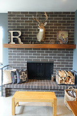 Rustic Brick Fireplace (Heath & the B.L.T. boys) Tags: fireplace deer brick wood hearth firewood pillow basket livingroom