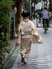 The Sprinting Maiko (Rekishi no Tabi) Tags: miyagawacho maiko apprenticegeiko apprenticegeisha kyoto japan leica