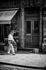 No comment! (guillaumegesret) Tags: dinan street monochrome moment streetview streetphotogrpahie streetphotographer structure streetart style scène story doors flowers city canon cute candid