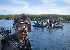 Sailor dives off the coast of Guam during a Western Pacific Naval Symposium diving exercise.