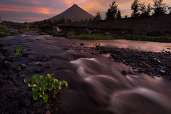 """It was that very moment when I was in this majestic scenery of Mayon Volcano in Cagsawa, Albay,  witnessed and captured such an amazing light show.    At that moment, all I wanted to do was to jump and shout """"Yes!!!!"""",  as I saw the sun rose from the East (Sean Aleta) Tags: tourismph albaytourism mayon spicyalbay fujifilmph fujifilm albay rokinon fscc volcano mhb hoyafiltersph manfrotto sunrise landscapes majesticmayon samyang hoya"""