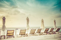 (Paemon) Tags: beach anguilla barnes bay chairs umbrella sky clouds ocean color day paemon sonydscrx100