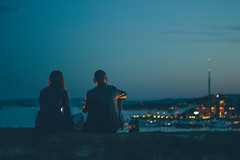 An Evening in Oslo (freyavev) Tags: oslo norway norge scandinavia capital night city bokeh cityatnight citylights dusk blues couple urban streetphotography fortress akershus oslofjord people niftyfifty mikasniftyfifty 50mm vsco canon canon700d grain graony